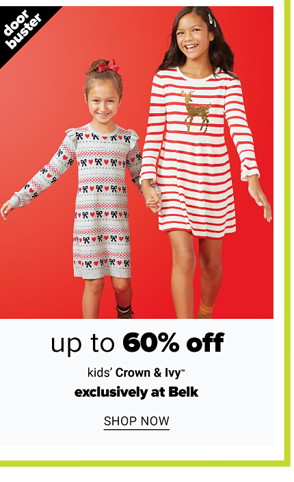 A girl wearing a white, red & green holiday themed patterned print long sleeved nightgown standing next to a girl wearing a white & red horizontal striped nightgown with a brown reindeer front graphic. Doorbuster. Up to 60% off kids' Crown & Ivy. Exclusively at Belk. Shop now.