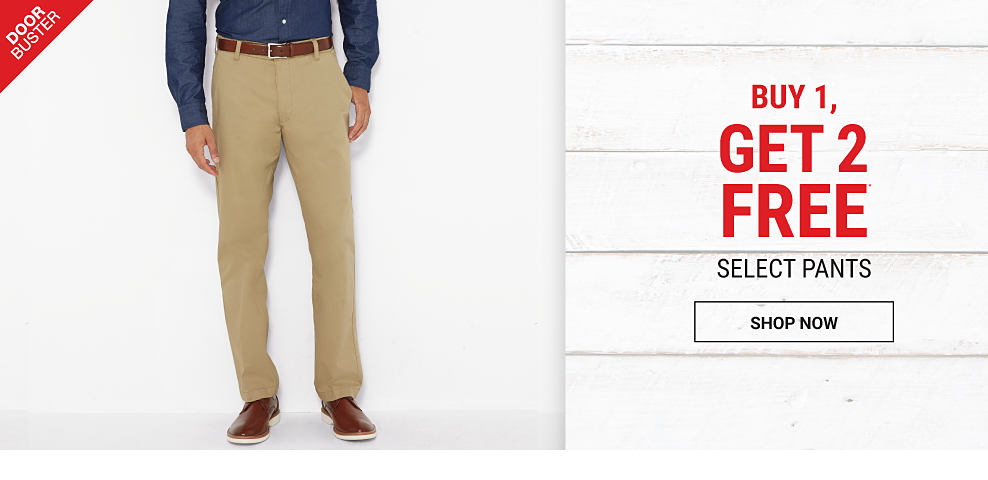 A man wearing a navy button-front shirt, beige pants & brown leather shoes. DoorBuster. Buy 1, Get 2 free select pants. Free items must be of equal or lesser value. Shop now.