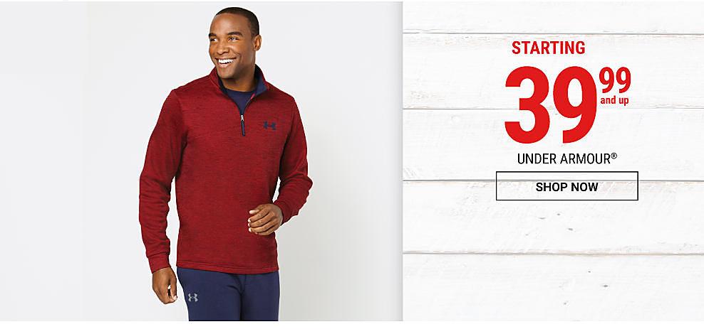 A man wearing a red Under Armour quarter-zip fleece & navy workout pants. DoorBuster. 39.99 & up Under Armour. Shop now.