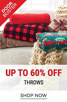An assortment of folded throws in a variety of colors & patterns on a couch. DoorBuster. Up to 60% off throws. Shop now.