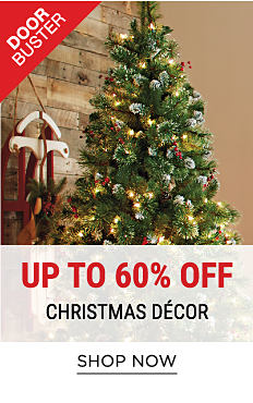 A Christmas tree decorated with ornaments. DoorBuster. Up to 60% off Christmas decor. Shop now.