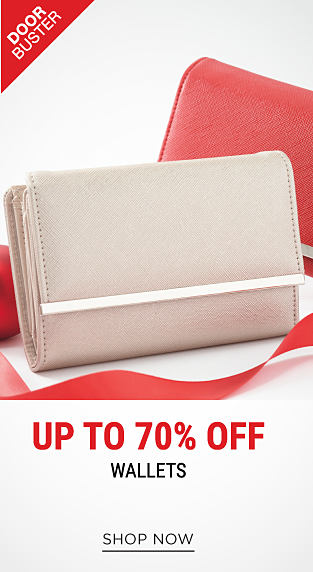 A cream colored leather women's wallet. A red leather women's wallet. DoorBuster. Up to 70% off wallets. Shop now.