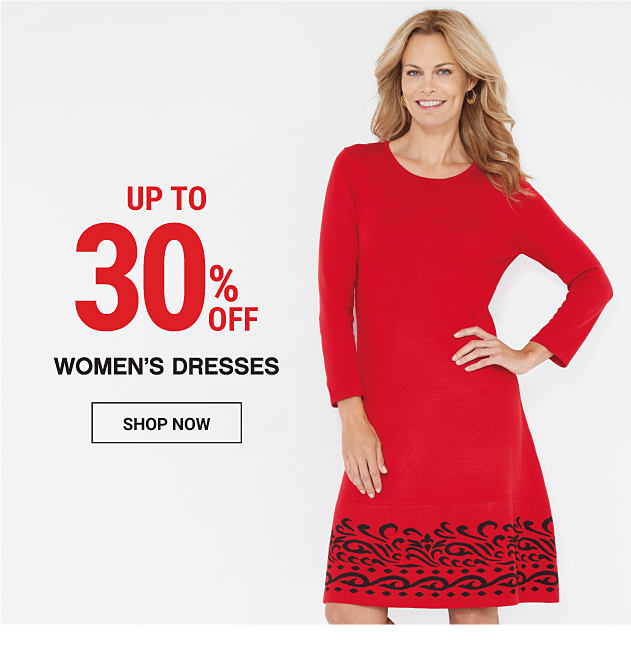 A woman wearing a red dress. Up to 30% off women's dresses. Shop now.