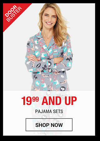 A woman wearing multi-colored print pajamas. DoorBuster. 19.99 & up pajama sets & robes. Shop now.