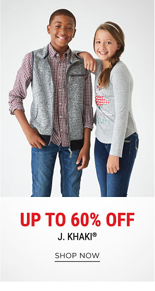 A boy wearing a gray & black fleece vest, a red, blue & white check button-front shirt, blue jeans & black shoes standing next to a girl wearing a gray, red & white long-sleeved graphic top, blue jeans & black suede booties. DoorBuster. Up to 60% off J Khaki. Shop now.
