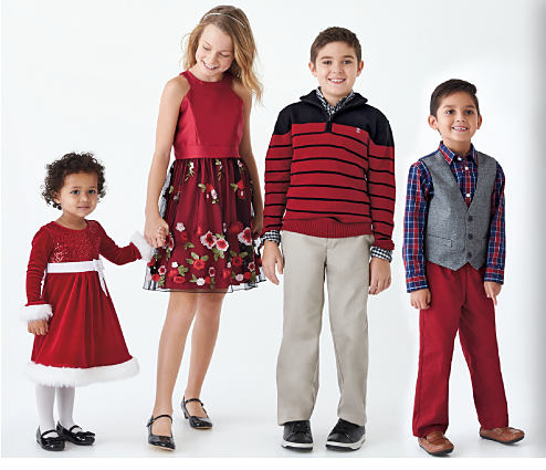 2 boys & 2 girls wearing various styles of holiday-themed apparel. DoorBuster. Up to 60% off kids' dresswear.