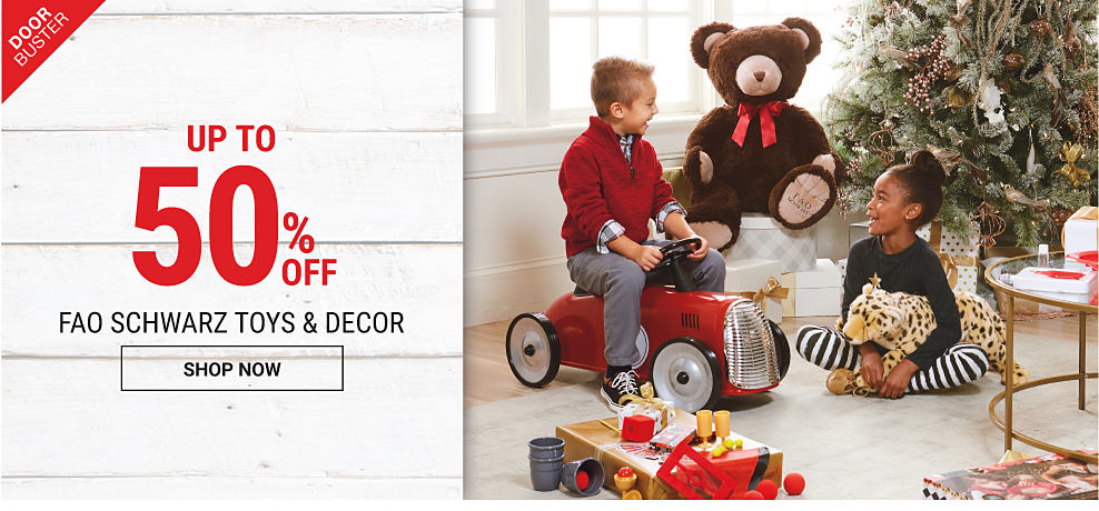 A boy & a girl playing with toys in front of a Christmas tree. Doorbuster. Up to 50% off F A O Schwarz toys & decor. Shop now.