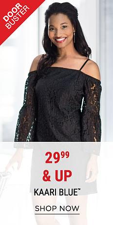 A woman wearing a black lace cold-shoulder dress. DoorBuster. 29.99 Kaari Blue. Shop now.