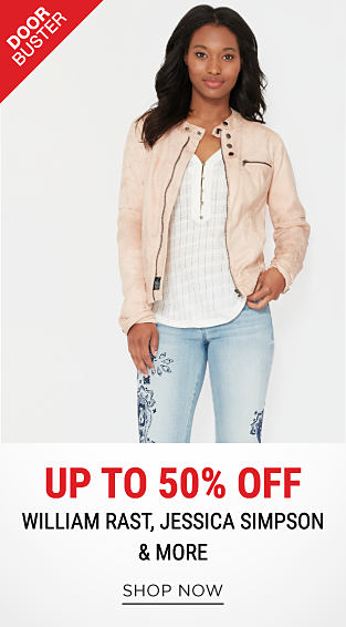 A woman wearing a cream colored jacket, a white top & blue jeans with black floral detail. DoorBuster. Up to 50% off William Rast, Jessica Simpson & more. Shop now.