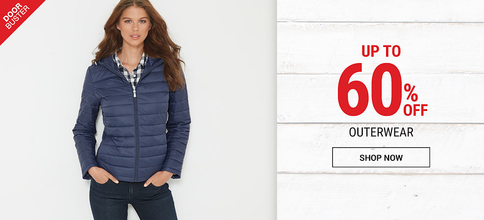 A woman wearing a blue & white plaid blouse, blue jeans & a navy puffer coat. DoorBuster. Up to 60% off outerwear. Shop now.