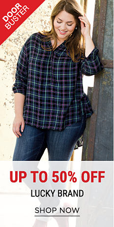 A woman wearing a blue, teal & purple plaid flannel shirt & blue jeans. DoorBuster. Up to 50% off Lucky Brand. Shop now.