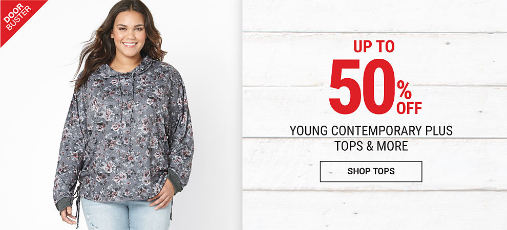 A young woman wearing a black, white & gray hoodie & distressed blue jeans. DoorBuster. Up to 50% off young contemporary plus tops & more. Shop tops.