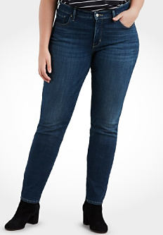 A young woman wearing a black & white horizontal striped short sleeved top, blue jeans & black suede booties. Shop jeans.