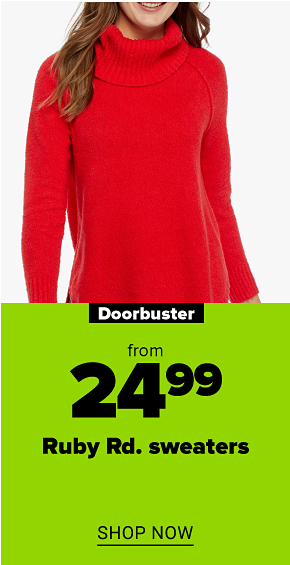 A woman in a red turtleneck sweater. Doorbuster from $24.99 Ruby Rd sweaters. Shop now.