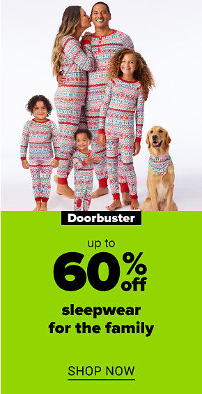 A man, a woman and a girl in matching holiday pajama sets. The man's shirt reads dad elf, the woman's shirt reads mom elf and the girl's shirt reads elf in training. Doorbuster. Up to 70% off sleepwear for the family. Shop now.