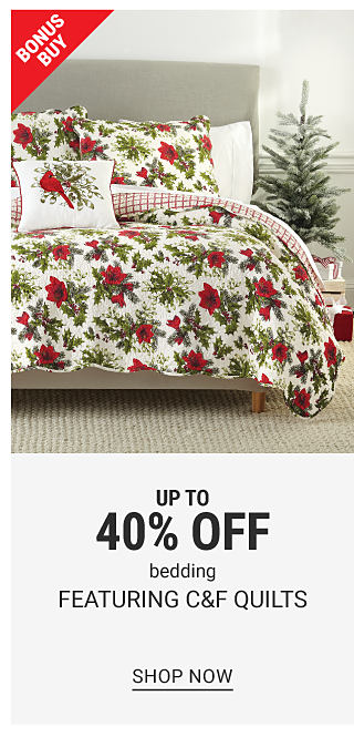 A bed made with a white, red & green poinsettia patterned print comforter & matching pillows. Bonus Buy. Up to 40% off bedding featuring C & F quilts. Shop now.