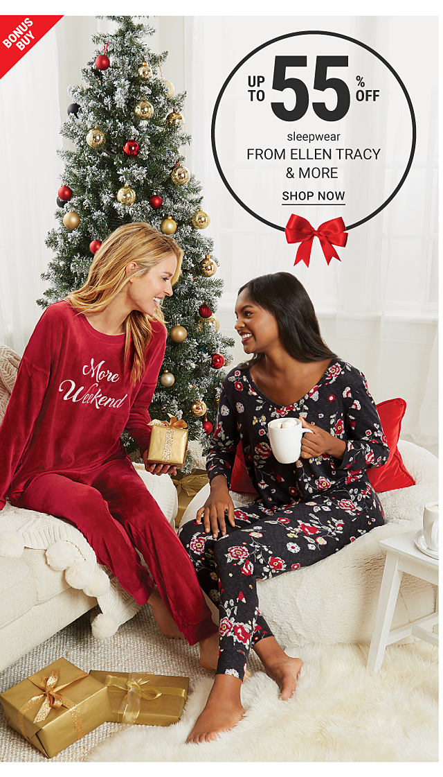 One woman in red pajamas and another woman in black pajamas with a floral print. Bonus buy. Up to 55% off sleepwear from Ellen Tracy and more. Shop now.