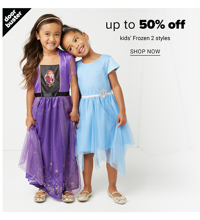A girl wearing a lavender short sleeved dress with a Frozen 2 front graphic standing next to a girl wearing a light blue short sleeved dress. Doorbuster. Up to 50% off kids Frozen 2 styles. Shop now.