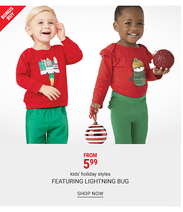 A boy wearing a red long sleeved shirt with a multi colored holiday themed front graphic, green pants & gray sneakers. A girl wearing a red long sleeved top with a multi colored holiday themed front graphic, green pants & black shoes. Bonus Buy. $5.99 kids holiday styles featuring Lightning Bug. Shop now.