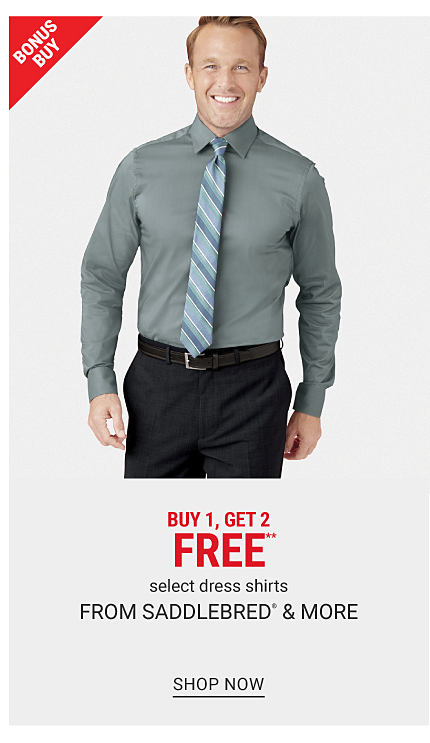 A man wearing a dark gray dress shirt, a blue, light blue & white striped tie, black pants & brown shoes. Bonus Buy. Buy 1, Get 2 Free select dress shirts from Saddlebred & more. Free or discounted items must be of equal or lesser value. Shop now.
