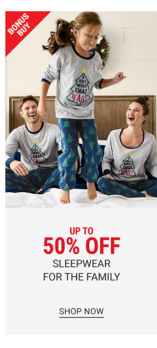 A woman, a girl, a boy & a man all wearing matching white, red & green patterned print holiday pajamas. Bonus Buy. Up to 50% off sleepwear for the family. Shop now.