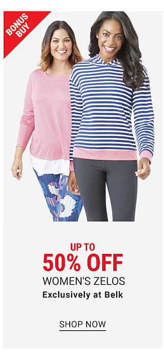 a woman wearing a pink long sleeved top, multi colored print pants & blue sneakers standing next to a woman wearing a blue & white horizontal striped long sleeved top, dark gray pants & gray sneakers. Up to 50% off women's Zelos. Exclusively at Belk. Shop now.