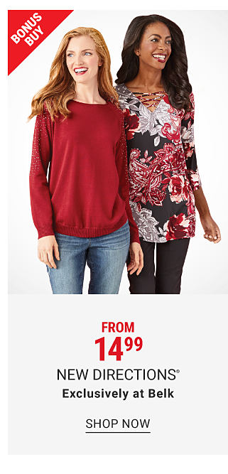 A woman wearing a red long sleeved top, blue jeans & black flats standing next to a woman wearing a black, red & white floral print long sleeved top, black pants & black boots. From $19.99 New Directions. Shop now.