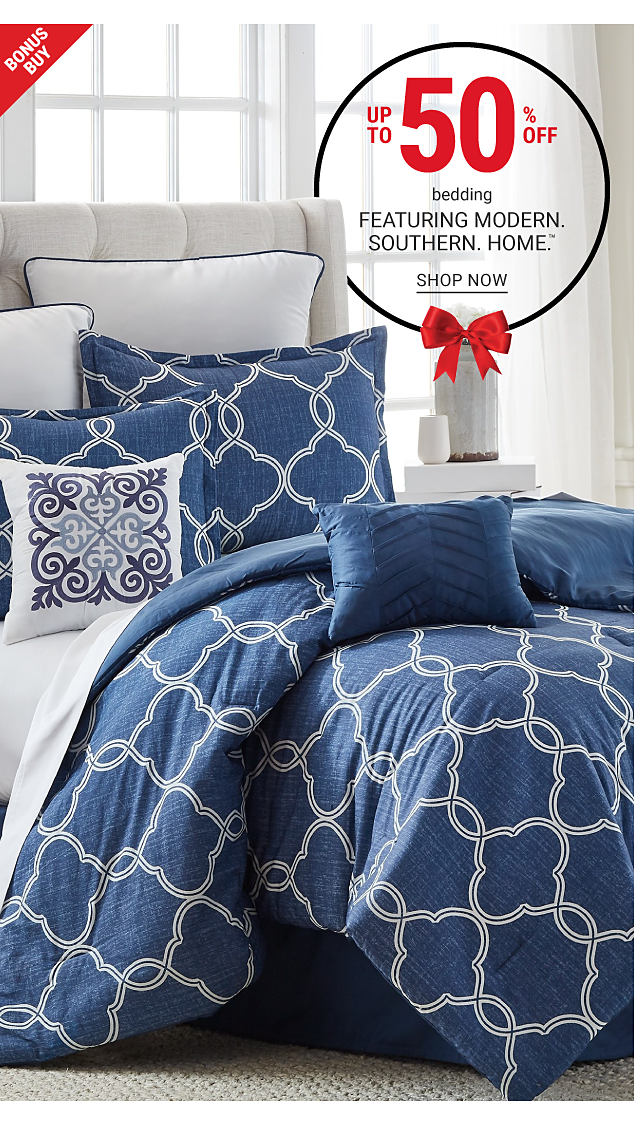A bed made with a blue & white patterned print comforter & matching pillows. Bonus Buy. Up to 50% off bedding featuring Modern Southern Home. Shop now.