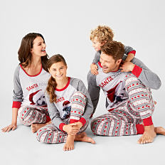 A family wearing matching holiday pajamas. Shop sleepwear for the family.