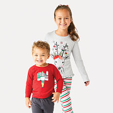 A girl and a boy wearing holiday apparel. Shop holiday apparel.