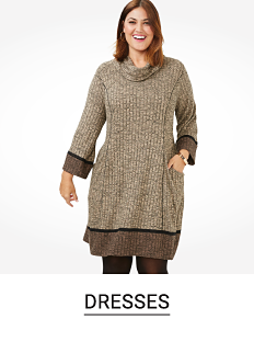 A woman in a light and dark brown sweater dress. Shop dresses.