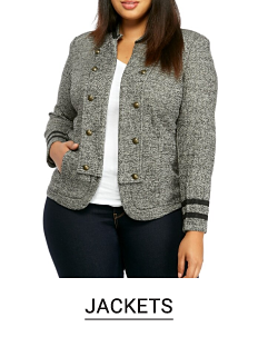 A woman in a white top, gray jacket and jeans. Shop jackets.