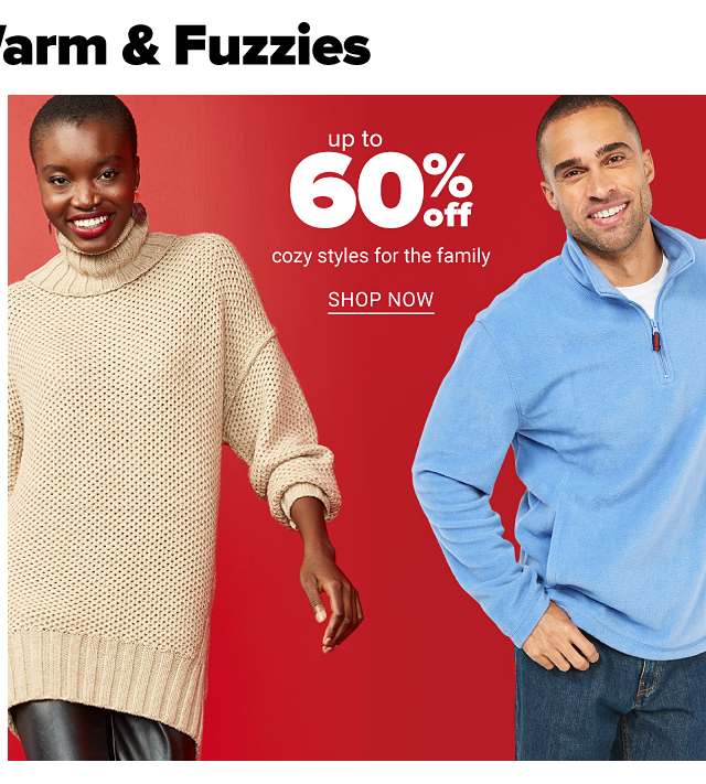 A woman wearing a beige sweater & black leather pants. A man wearing a light blue quarter zip fleece over a white shirt & blue jeans. Up to 60% off cozy styles for the family. Shop now.