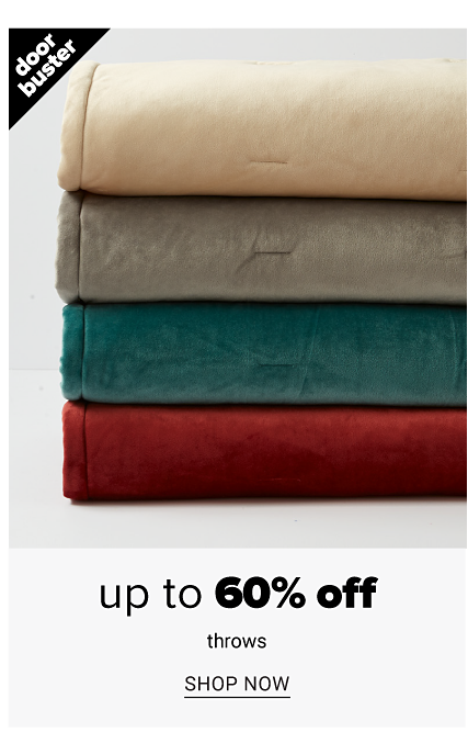 A stack of folded throws in a variety of colors. Doorbuster. Up to 60% off throws. Shop now.