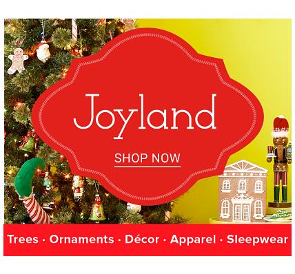 A fully decorated Christmas tree. Joyland. Trees. Ornaments. Decor. Apparel. Sleepwear. Shop now.