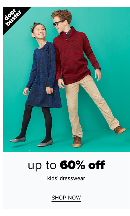 A girl wearing a navy long sleeved dress, black leggings & gray flats standing next to a boy wearing glasses, burgundy sweater, beige pants & brown shoes. Doorbuster. Up to 60% off kids dresswear. Shop now.