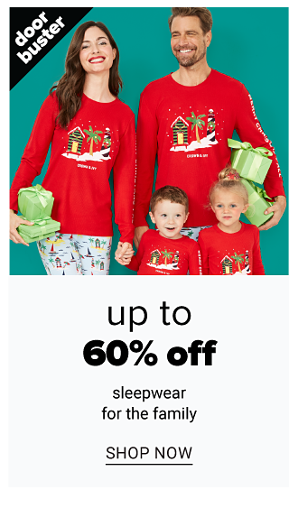A woman, man, boy & girl wearing matching red long sleeved pajama tops with multi colored holiday themed front graphic & white pajama pants with multi colored patterned print. Doorbuster. Up to 60% off sleepwear for the family. Shop now.
