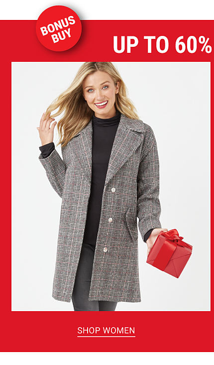 Bonus Buy. Up to 60% off Outerwear for the Family. A woman wearing a gray peacoat over a black long sleeved top & gray pants. Shop women.