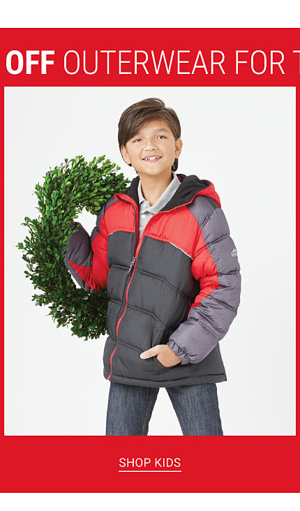 Bonus Buy. Up to 60% off Outerwear for the Family. A boy wearing black, red & gray puffer coat over a gray shirt & blue jeans. Shop kids.