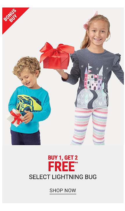 A boy wearing a long sleeved shirt with a blue & yellow car front graphic & navy pants standing next to a girl wearing a purple long sleeved top with a multi colored castle front graphic & multi colored horizontal striped pants. Bonus Buy. Buy 1, Get 2 Free select Lightning Bug. Free or discounted items must be of equal or lesser value. Shop now.