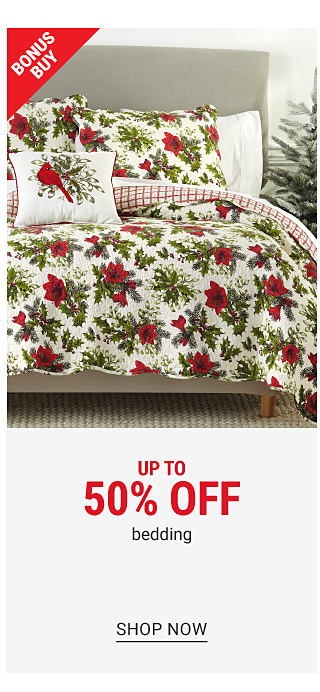 A bed made with a red, green & white poinsettia print comforter & matching pillows. Bonus Buy. Up to 50% off bedding. Shop now.