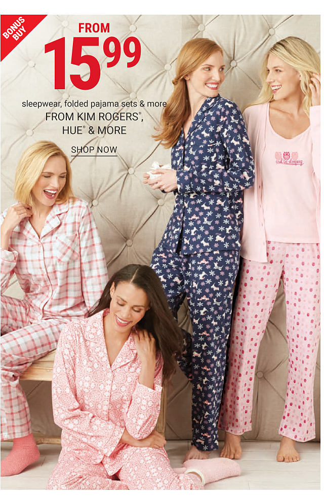 A woman wearing pink & white plaid pajamas sitting next to a woman wearing pink & white print pajamas, a woman wearing multi colored print pajamas & s woman wearing a pink cardigan over a pink top with a purple front graphic & lounge pants with a pink, white & purple dot patterned print. Bonus Buy. $15.99 sleepwear, folded pajama sets & more. Shop now.