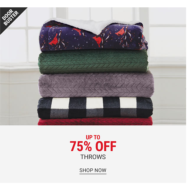 A stack of throws in a variety of prints and colors. Doorbuster. Up to 70% off throws. SHOP NOW