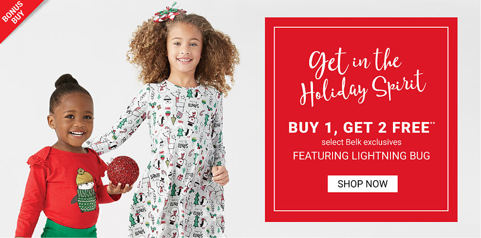 A girl wearing a red long sleeved top with a multi colored front graphic and green pants standing next to a girl wearing a white long sleeved dress with a multi colored snowmen & Christmas tree all over print. Get in the Holiday Spirit. Buy 1, Get 2 Free select Belk exclusives featuring Lightning Bug. Free or discounted items must be of equal or lesser value. Shop now.