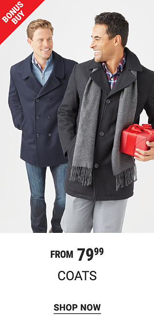 A man wearing a navy peacoat over a blue sweater & blue jeans standing next to a man wearing a black peacoat over a plaid button front shirt, a gray scarf & gray pants. Bonus Buy. From $79.99 coats. Shop now.