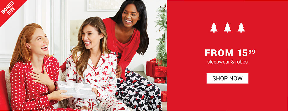 A woman wearing red pajamas with white dots sitting next to a woman wearing white pajamas with an all over red cardinal print & woman wearing a red long sleeved pajama top & white, navy & red all over print lounge pants. Bonus Buy. From $15.99 sleepwear & robes. Shop now.