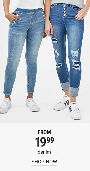 A woman wearing a white short sleeved top. blue jeans & white sneakers standing next to a woman wearing a gray short sleeved top, blue jeans & white sneakers. From $19.99 denim. Shop now.