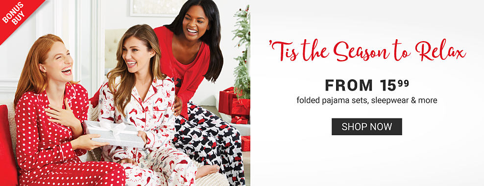 A woman wearing red pajamas with white dots sitting next to a woman wearing white pajamas with an all over red cardinal print & woman wearing a red long sleeved pajama top & white, navy & red all over print lounge pants. Tis the Season to Relax. Bonus Buy. From $15.99 folded pajama sets, sleepwear & more. Shop now.