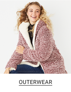 A girl in a pink reversible cozy coat. Outerwear.