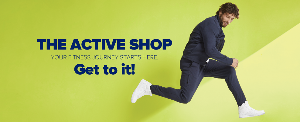 A man in black jogger pants, a black zip jacket and white high-top sneakers. The active shop. Your fitness journey starts here. Get to it